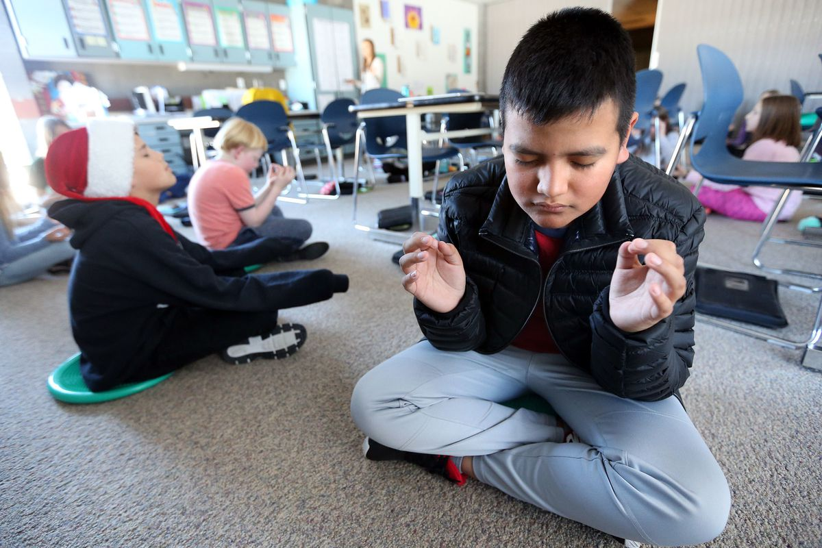 Cayetano Alvarado does a breathing meditation exercise at Ecker Hill Middle School in Park City on Tuesday, Dec. 12, 2017.
