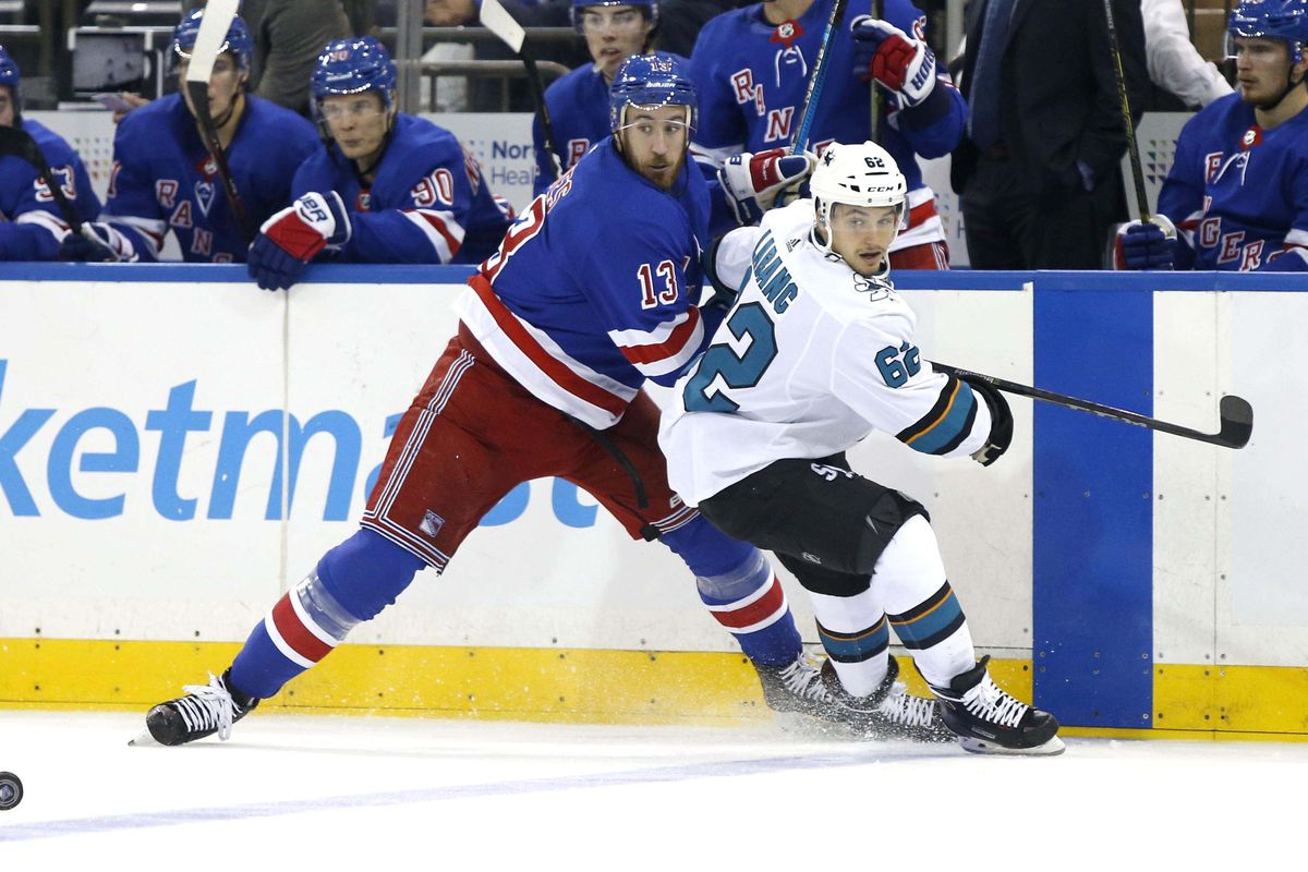 Oct 11, 2018; New York, NY, USA; New York Rangers center Kevin Hayes (13) defends against San Jose Sharks right wing Kevin Labanc (62) during second period at Madison Square Garden.