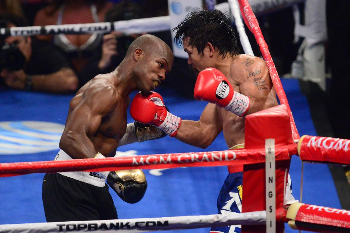 Jun. 9, 2012; Las Vegas, NV, USA; Manny Pacquiao (right) punches Timothy Bradley Jr during a welterweight championship bout at the MGM Grand Garden Arena. Mark J. Rebilas-US PRESSWIRE