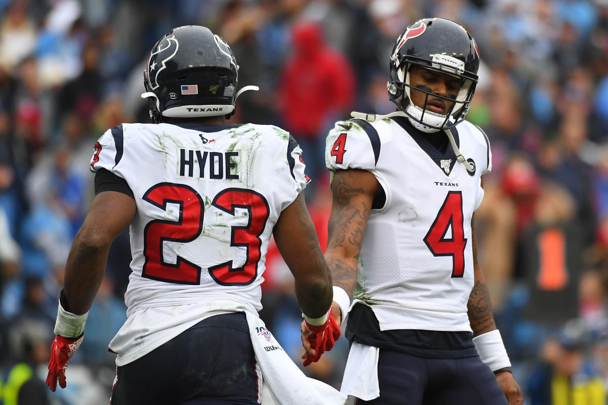Houston Texans running back Carlos Hyde and Houston Texans quarterback Deshaun Watson celebrate after a touchdown during the second half against the Tennessee Titans at Nissan Stadium.