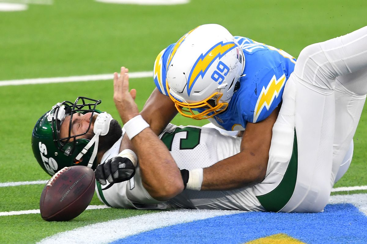 Los Angeles Chargers defensive tackle Jerry Tillery (99) hits New York Jets quarterback Joe Flacco (5) the second half at SoFi Stadium