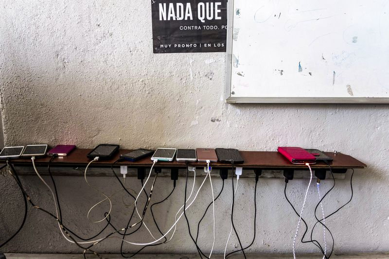 Cellphones of asylum seekers wanting to stay in the US charge in Juventud 2000 migrant shelter, in Tijuana, on March 5, 2019.
