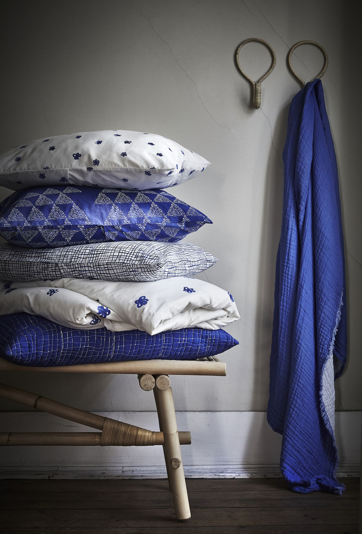 Blue and white pillows on chair