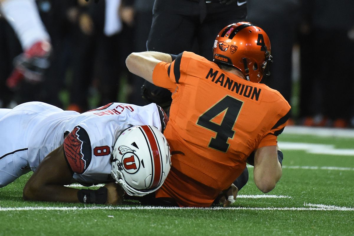 Utah defensive end Nate Orchard (8), shown here sacking Oregon State quarterback Sean Mannion, has been a terror to offensive backfields. And with the Utes leading the nation in sacks, some have begun to call Utah's capitol, Sack Lake City.