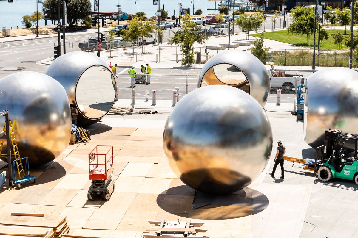 Five large steel globe-like structures in a circle, with mirrored inlays facing each other. It's still under construction.