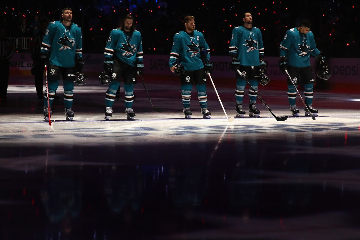 Tomas Hertl, Erik Karlsson, Joe Pavelski, Brenden Dillon and Evander Kane of the San Jose Sharks stand for the national anthem in Game 1 NHL Western Conference Final during the 2019 NHL Stanley Cup Playoffs at SAP Center on May 11, 2019.