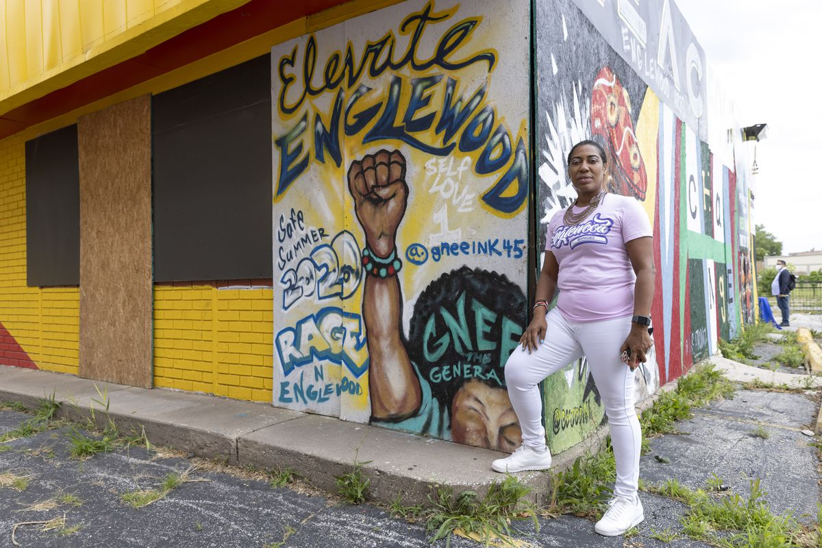 Asiaha Butler, executive director of the Resident Association of Greater Englewood, shown next to a mural at Englewood Market & Resource Days, 6608 S. Halsted St. in Englewood on Wednesday, June 23, 2021.