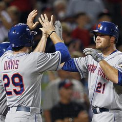 New York Mets right fielder Lucas Duda (21) celebrates with Ike Davis (29) after hitting a three-run home run in the seventh inning of a baseball game against Atlanta Braves in Atlanta, Friday,  Sept. 28, 2012.