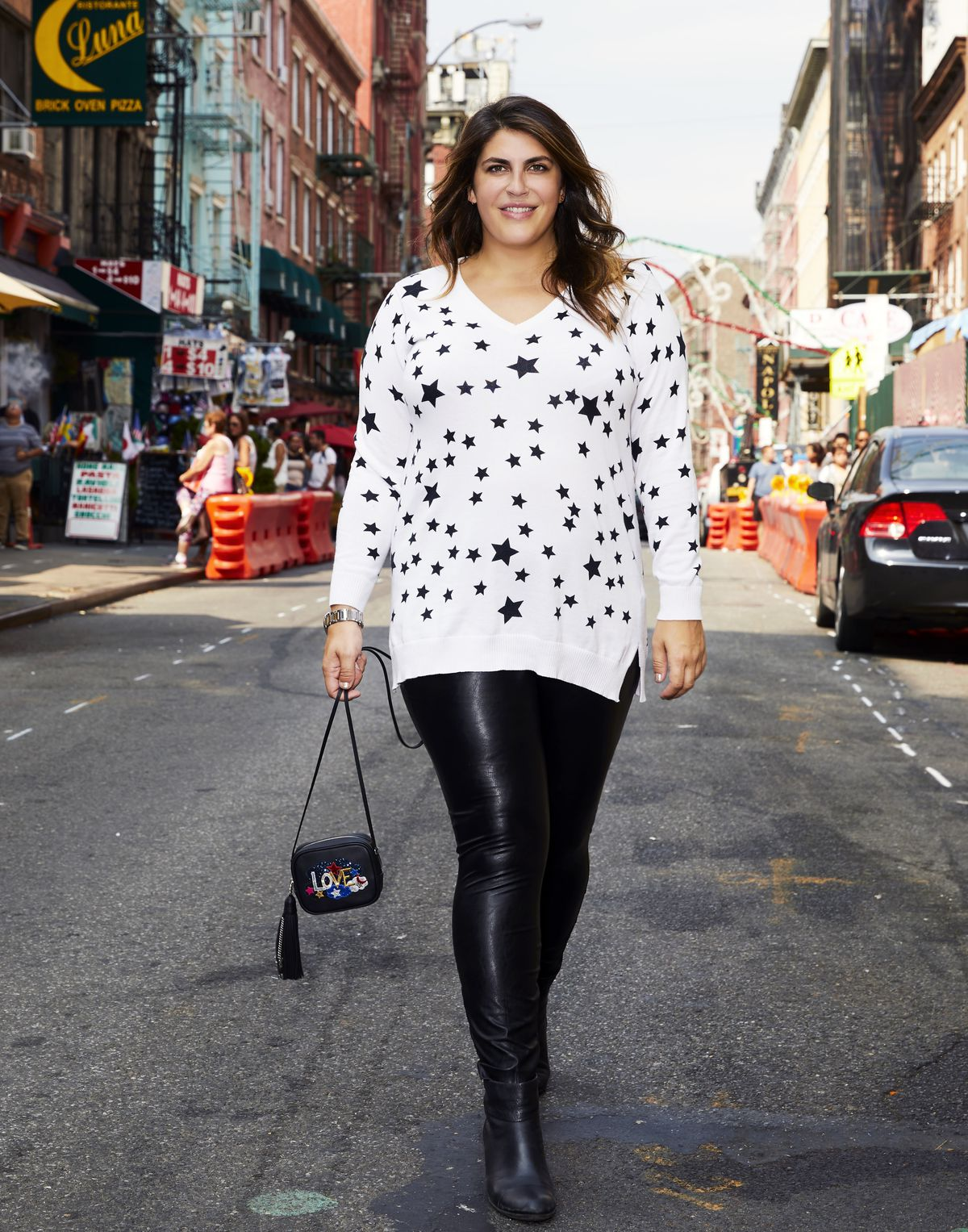 Star sweater and faux leather leggings