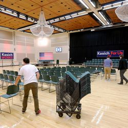 Workers get the Grande Ballroom ready for Ohio Gov. John Kasich to hold a town hall meeting at Utah Valley University, Friday, March 18, 2016.