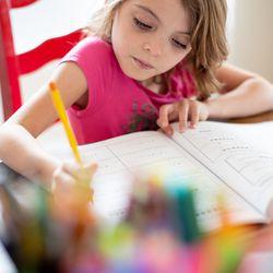 Vivian Seger, 6, does her homework at her home in southern Jordan on Thursday, October 7, 2021.