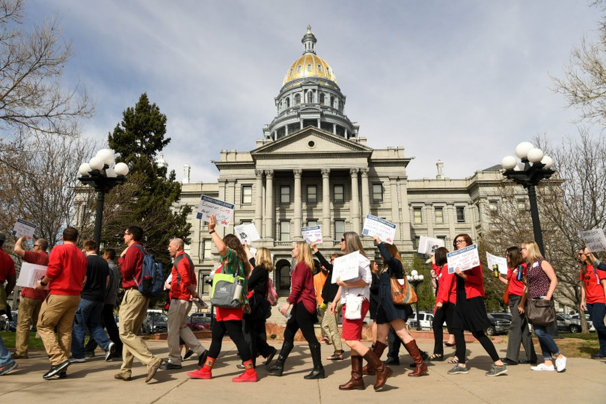Colorado educators rally for more state funding outside the Colorado State Capitol in April 2018.