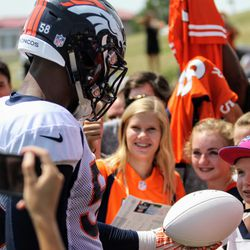 Broncos OLB Von Miller makes many children's day when signing autographs after practice.