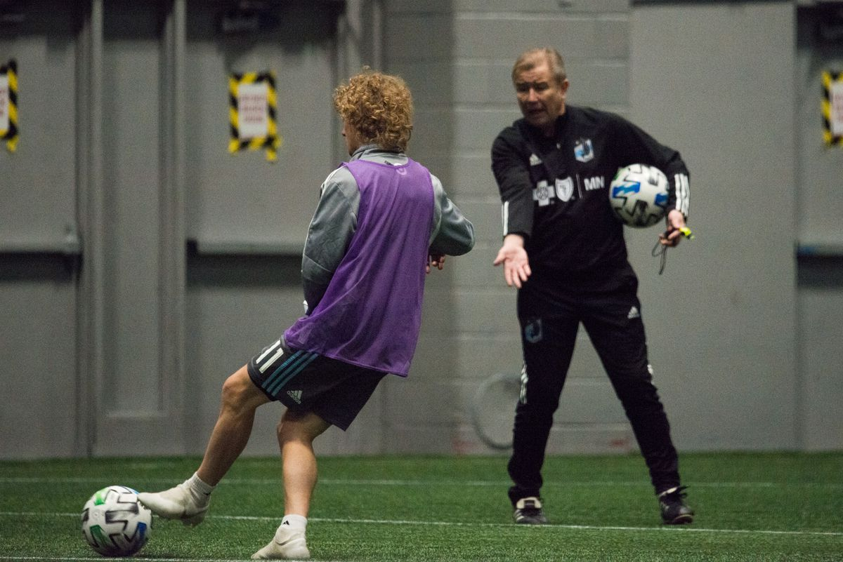 January 21, 2020 - Blaine, Minnesota, United States - Adrian Heath gives instruction to Thomas Chacon during a training at National Sports Center. (Photo by Tim McLaughlin)