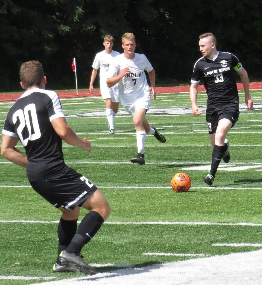 Andrew Bucur (33) advances up the pitch.