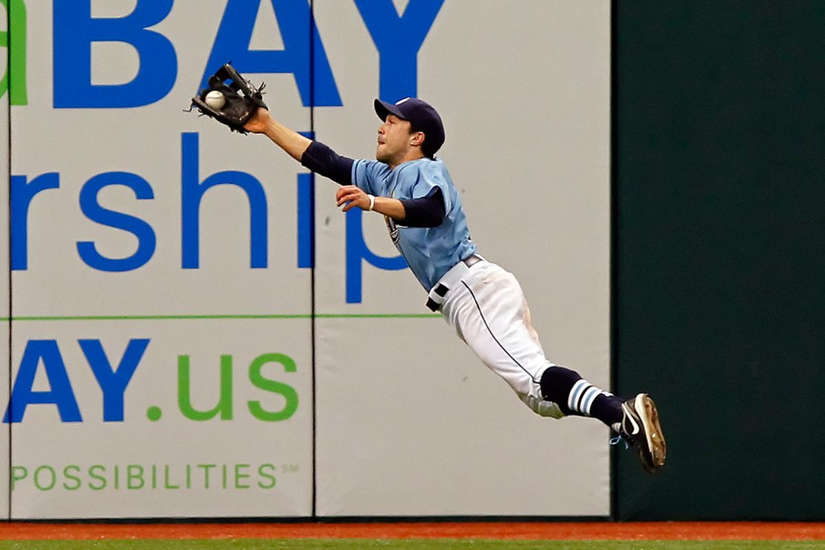 ST PETERSBURG, FL - JUNE 19:  Outfielder Sam Fuld #5 of the Tampa Bay Rays makes a diving catch against the Florida Marlins during the game at Tropicana Field on June 19, 2011 in St. Petersburg, Florida.  (Photo by J. Meric/Getty Images)
