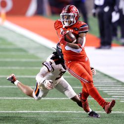 Utah Utes wide receiver Tyrone Young-Smith (3) runs away from Oregon State Beavers defensive back Jaydon Grant (3) as Utah and Oregon State play a college football game at Rice Eccles stadium in Salt Lake City on Saturday, Dec. 5, 2020. Utah won 30-24.