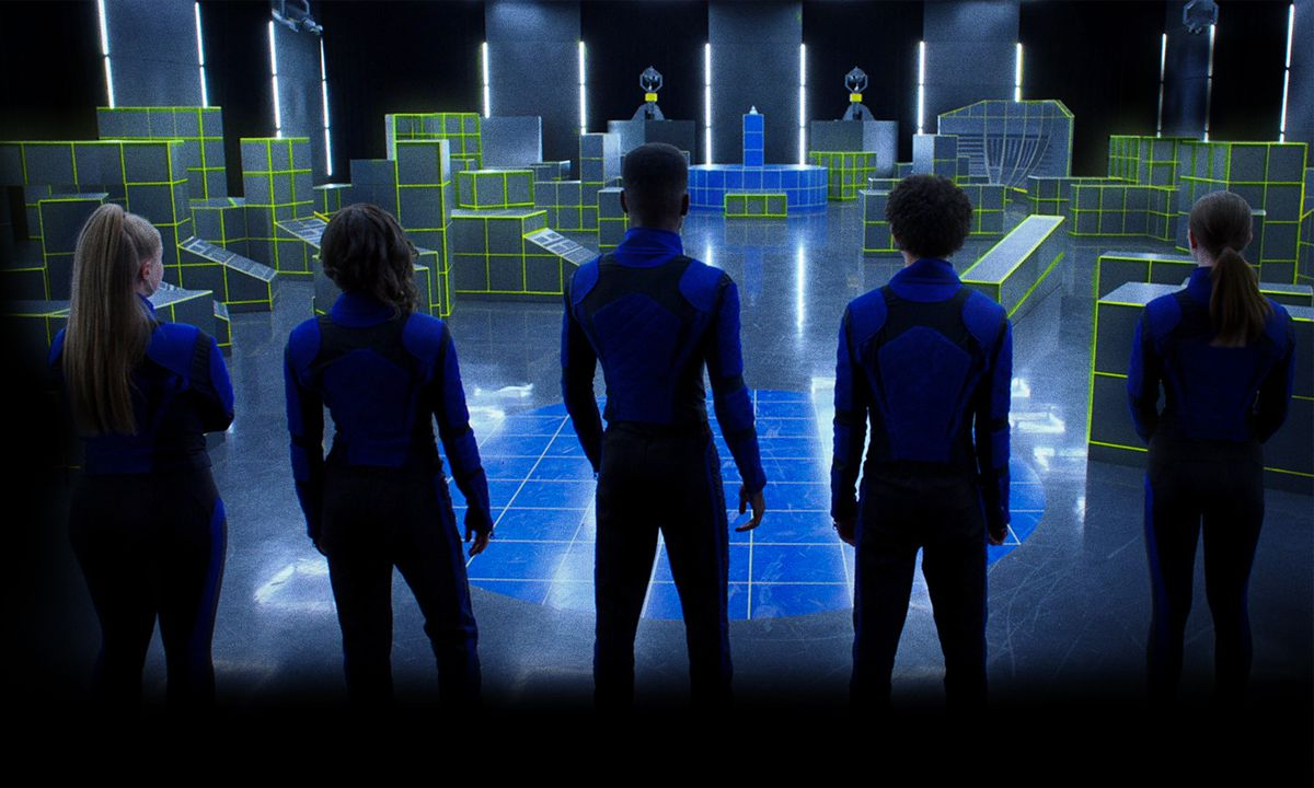 the five royals in front of a laser obstacle course