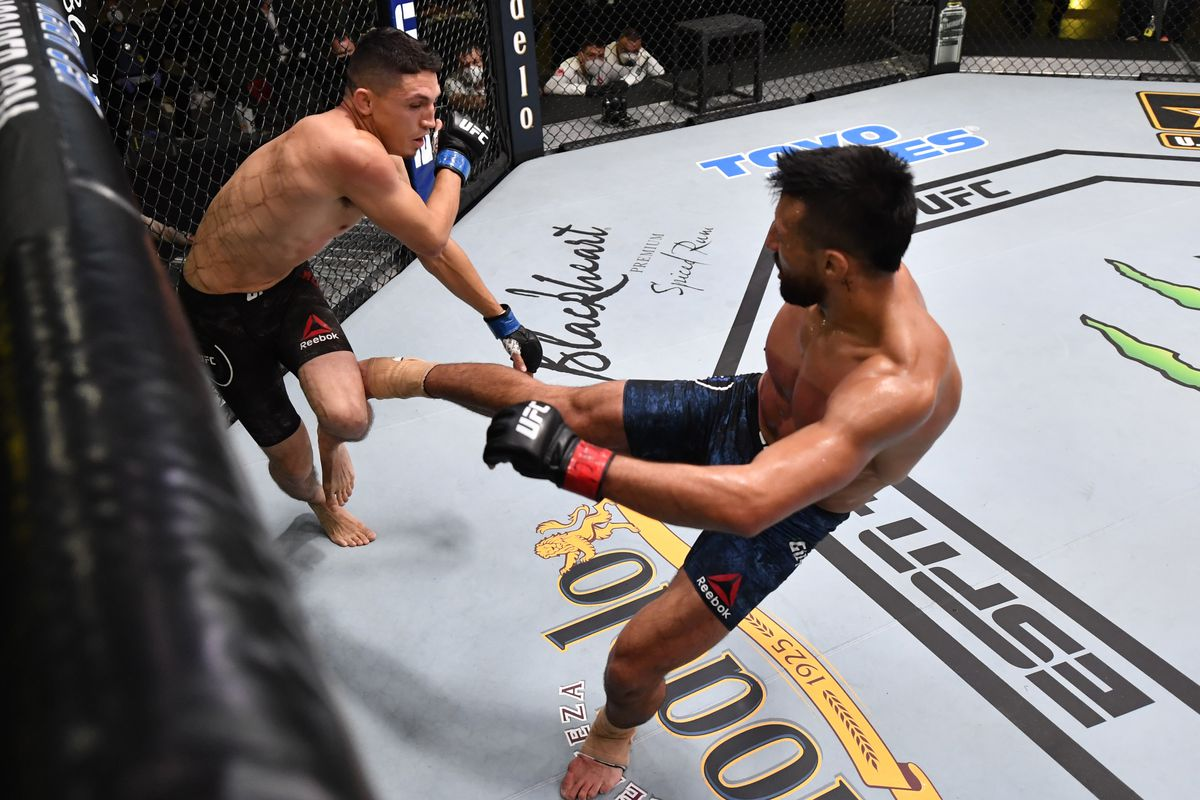 Chris Gutierrez kicks Vince Morales in their featherweight fight during the UFC Fight Night event at UFC APEX on May 30, 2020 in Las Vegas, Nevada.
