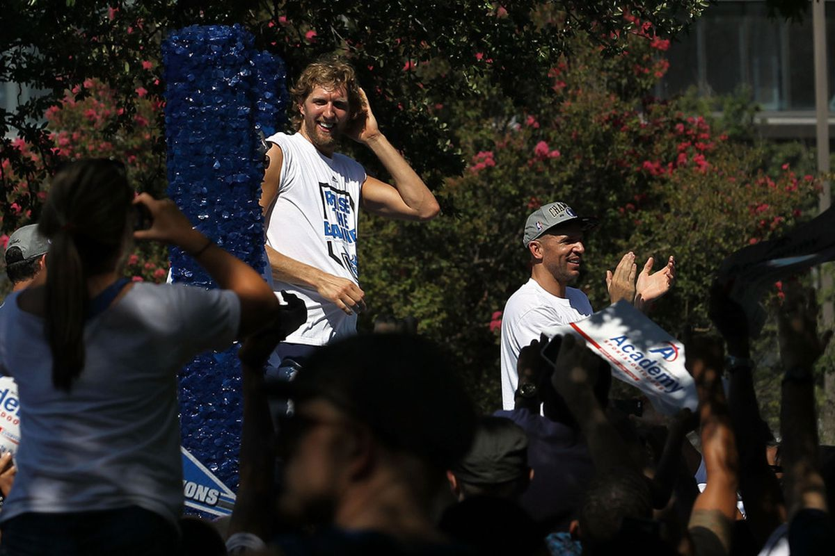 DALLAS, TX - JUNE 16:  Dirk Nowitzki and Jason Kidd celebrate during the Dallas Mavericks Victory Parade on June 16, 2011 in Dallas, Texas.  (Photo by Ronald Martinez/Getty Images)