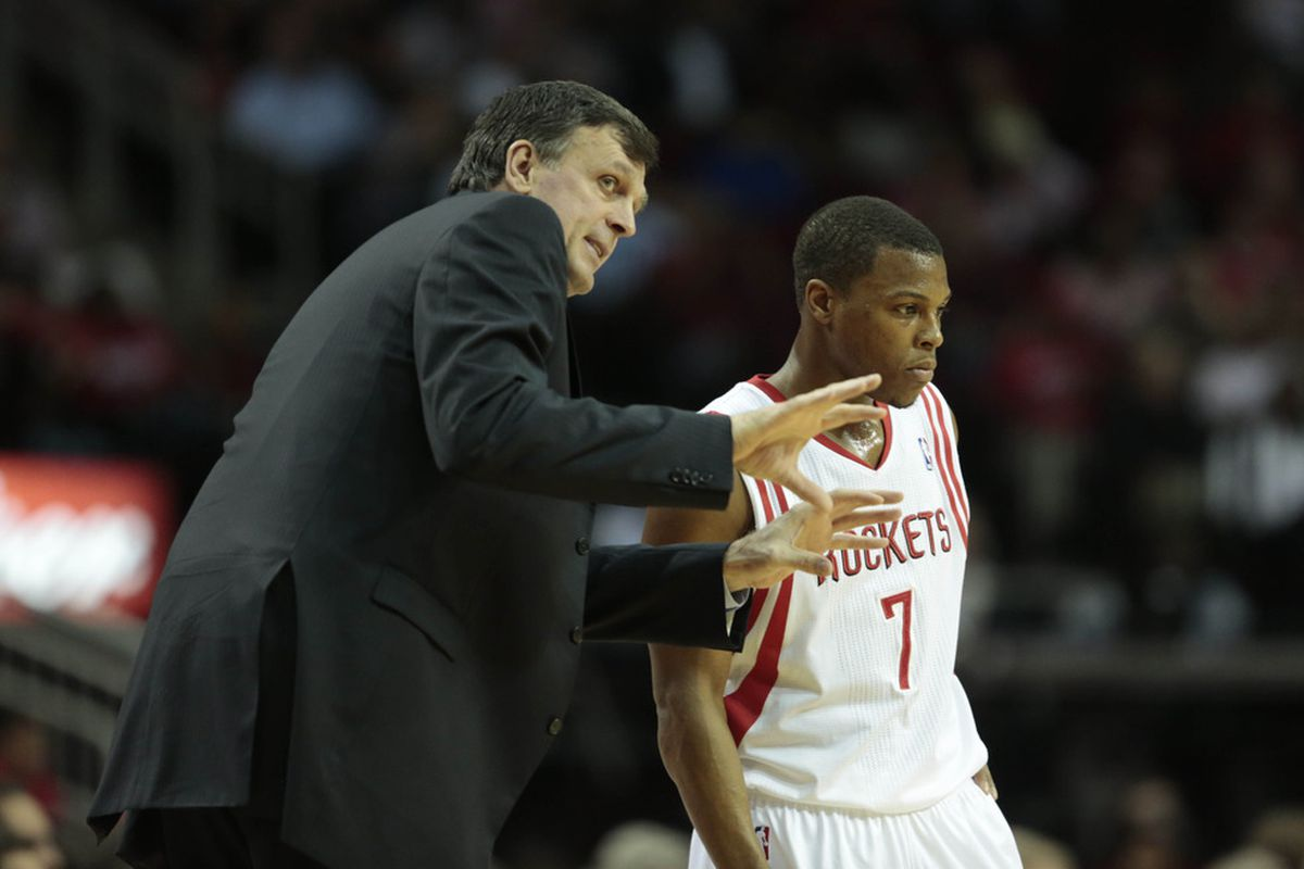 April 16, 2012; Houston, TX, USA; Houston Rockets head coach Kevin McHale talks to point guard Kyle Lowry (7) against the Denver Nuggets during the second quarter at the Toyota Center. Mandatory Credit: Thomas Campbell-US PRESSWIRE