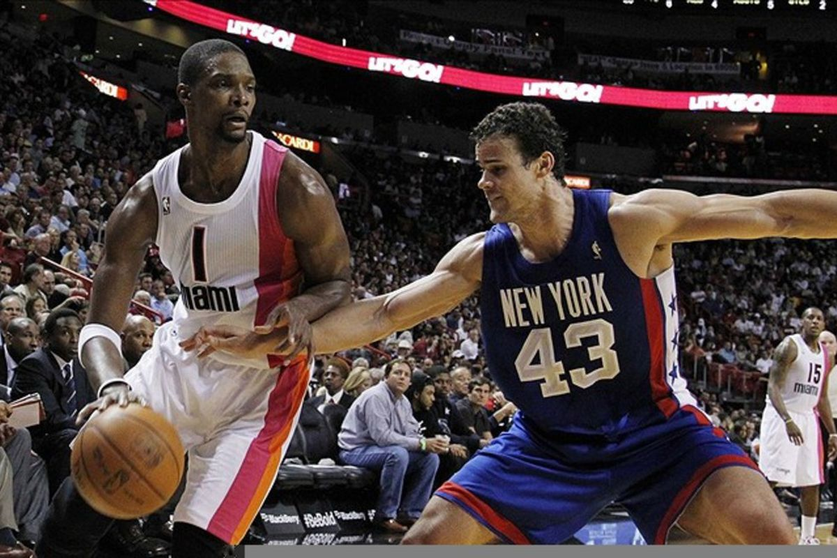 March 6, 2012; Miami, FL, USA; Miami Heat power forward Chris Bosh (1) goes past New Jersey Nets power forward Kris Humphries (43) in the third quarter at the American Airlines Arena. Mandatory Credit: Robert Mayer-US PRESSWIRE