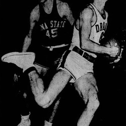 """""""Hey, Ump! This guy's traveling!"""" yells Dudley Ruisch of Iowa State as Drake's Art Ollrich tucks the ball under his arm and apparently starts sprinting downcourt during their game Friday night (Dec. 23, 1949) at the fieldhouse here. Ruisch scored 18 points for high honors, but the victory went to Drake in the last 25 seconds, 39-38."""