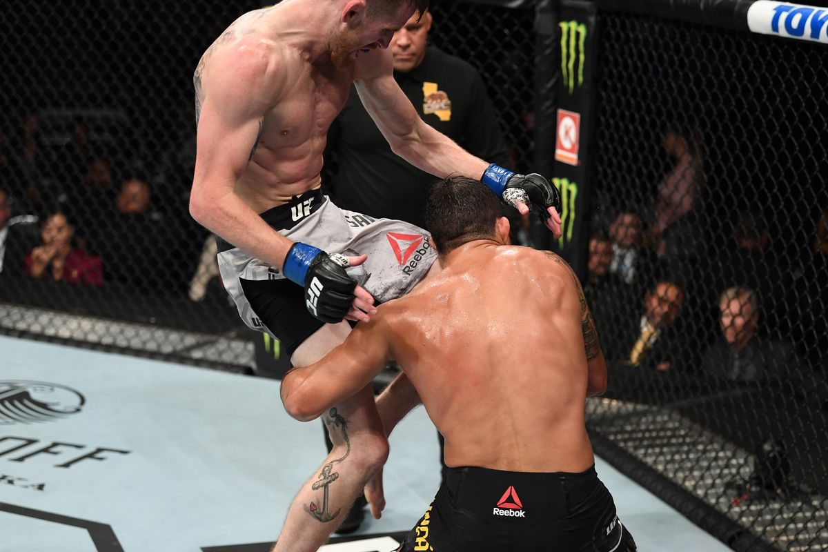 Cory Sandhagen knees Raphael Assuncao of Brazil in their bantamweight bout during the UFC 241 event at the Honda Center on August 17, 2019 in Anaheim, California.