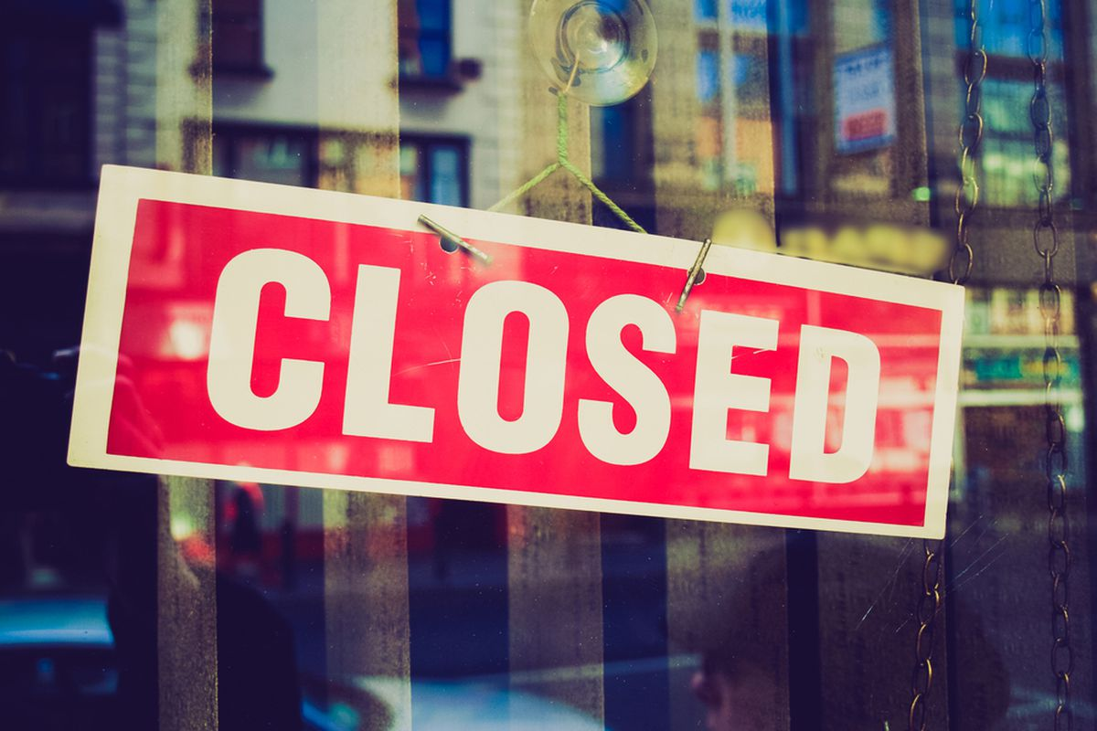 Stock photograph of a closed sign in a window