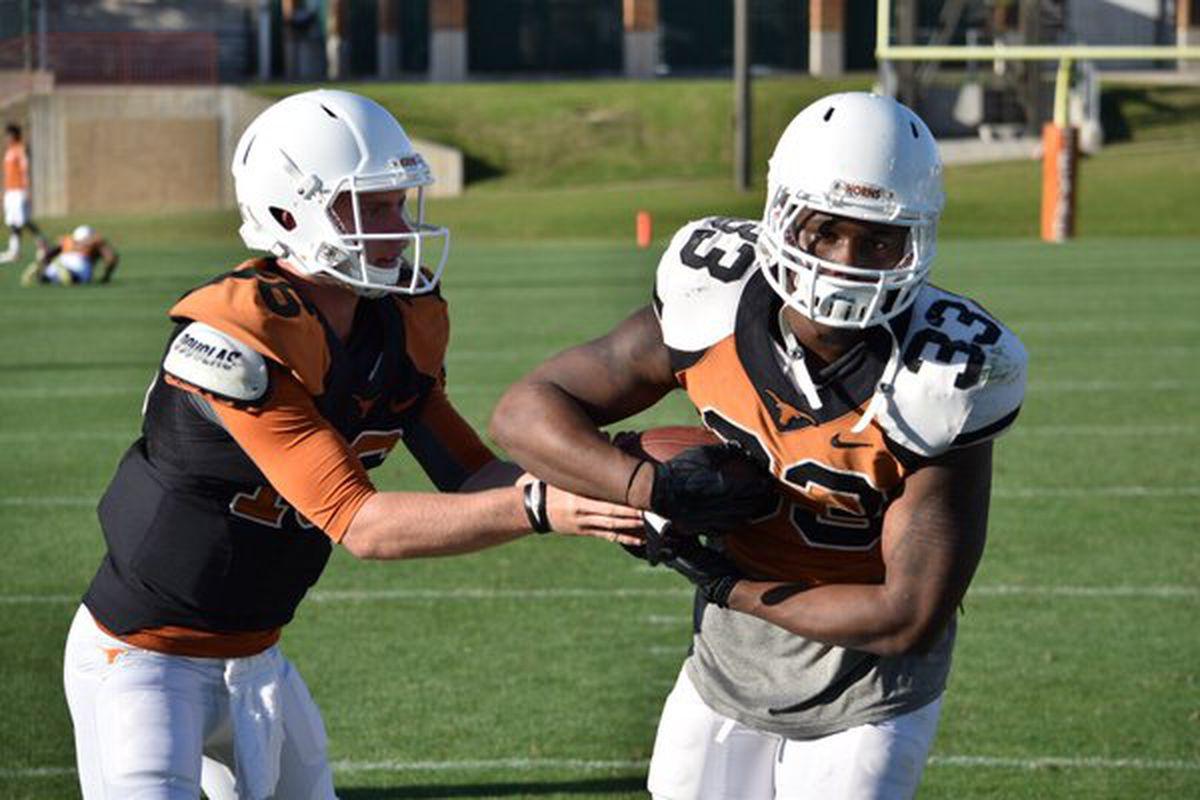 Shane Buechele (left) at practice