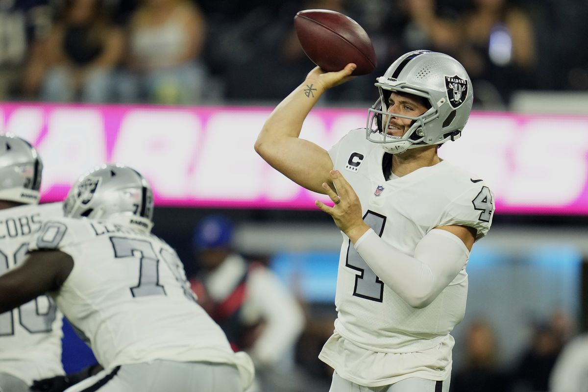 Las Vegas Raiders quarterback Derek Carr (4) throws a pass against the Los Angeles Chargers during the first half at SoFi Stadium.