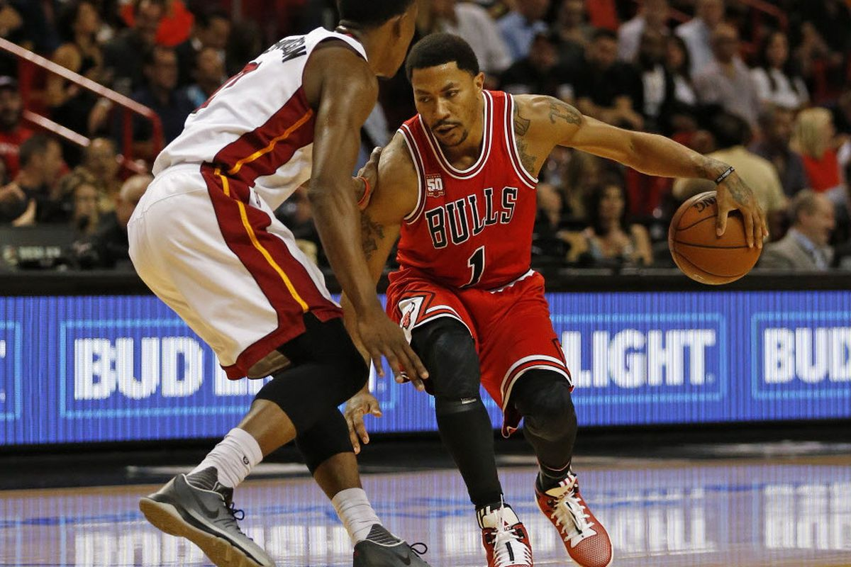 7f5a4803d815 Chicago Bulls Derrick Rose (1) dribbles the ball against Miami Heat s Josh  Richardson (0) during the first half of an NBA basketball game