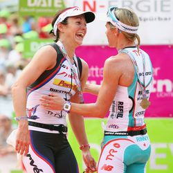 Mirinda Carfrae of Australia celebrates with second placed Rachel Joyce of Great Britain after winning the Challenge Roth on July 20, 2014 in Roth, Germany. (Photo by Alex Grimm/Getty Images)