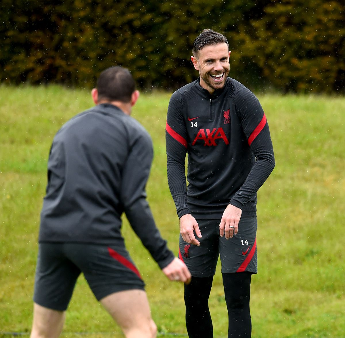 Henderson pictured laughing.