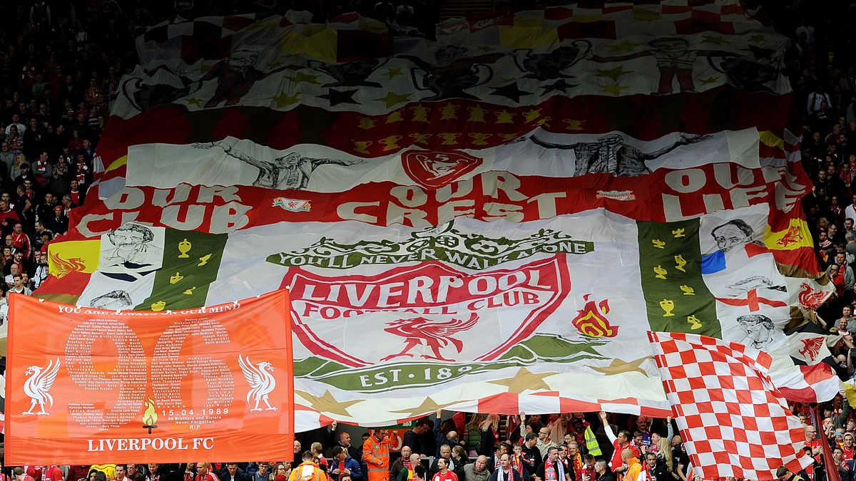 Flags and banners wave in the Kop of Liverpool before the Barclays Premier League match between Liverpool and Everton at Anfield on September 27, 2014 in Liverpool, England.