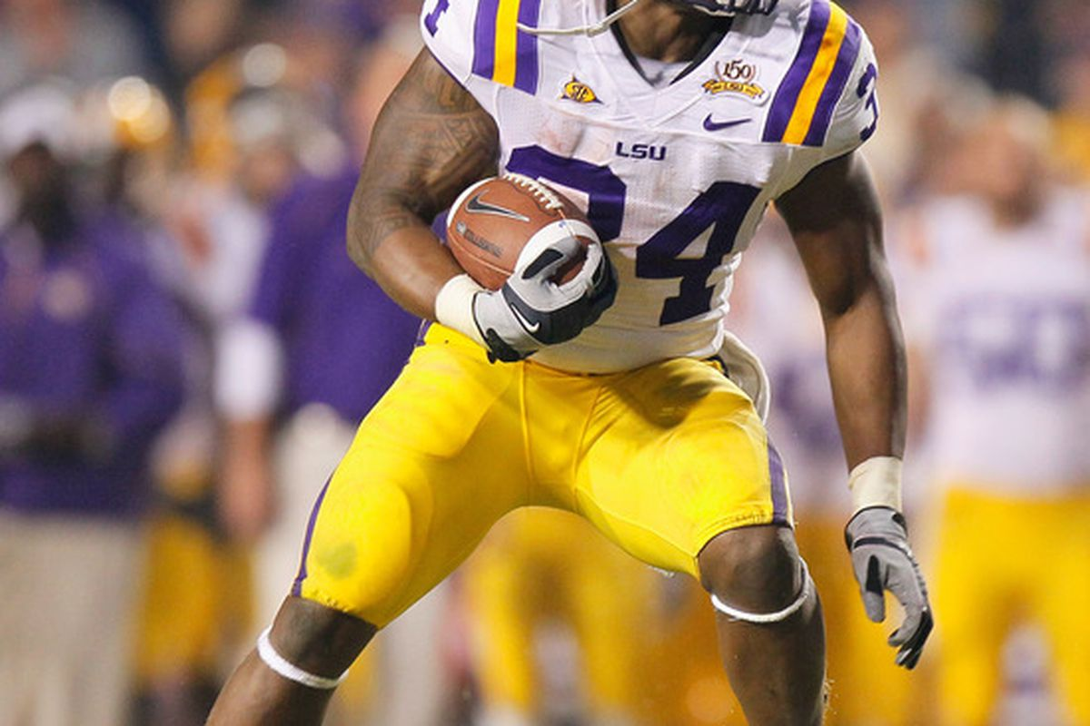 BATON ROUGE LA - NOVEMBER 20:  Stevan Ridley #34 of the Louisiana State University Tigers looks to rush upfield against the Ole Miss Rebels at Tiger Stadium on November 20 2010 in Baton Rouge Louisiana.  (Photo by Kevin C. Cox/Getty Images)