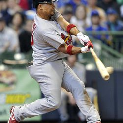 St. Louis Cardinals' Rafael Furcal singles to score a run against the Milwaukee Brewers during the fourth inning of a baseball game, Sunday, April 8, 2012, in Milwaukee.