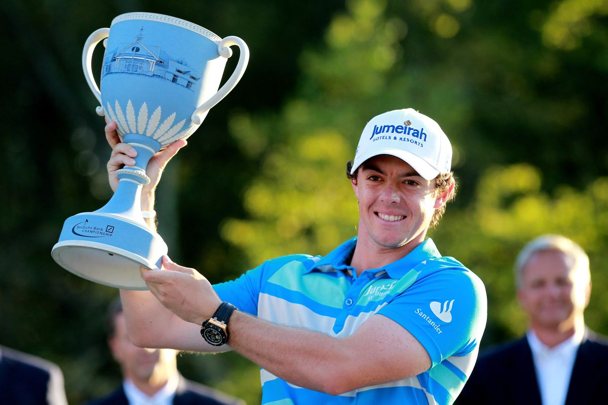 NORTON, MA - SEPTEMBER 03:  Rory McIlroy of Northern Ireland holds up the trophy after winning the Deutsche Bank Championship at TPC Boston on September 3, 2012 in Norton, Massachusetts.  (Photo by Jim Rogash/Getty Images)