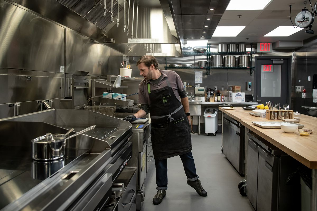 Rosati frying some chicken nuggets at the Shake Shack Innovation Kitchen