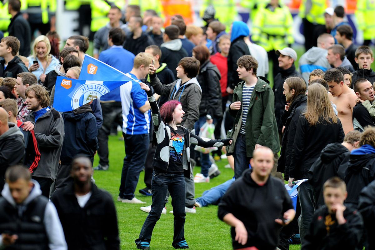 Wigan fans celebrate on the pitch at the end of the Barclays Premier League match between Wigan Athletic and West Ham United at the DW Stadium. <strong><em>Lets get the excitement back!!</em></strong>