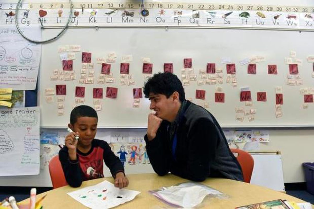 Substitute teacher Steven Mares, right, works with a student at Denver Green School in 2016. (Photo by Helen H. Richardson/The Denver Post)