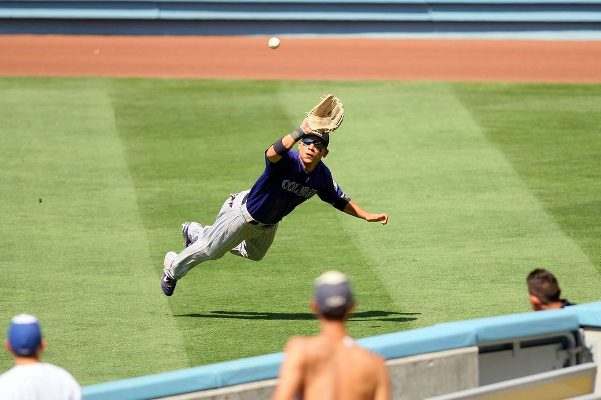 Carlos Gonzalez made a sweet diving catch to rob Justin Sellers from a two-run double in the fourth inning.