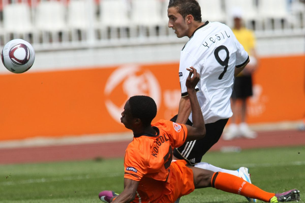 NOVI SAD, SERBIA - MAY 15: Samed Yesil (R) of Germany scores the first goal during the UEFA U17 Championships final match between Netherlands and Germany on May 15, 2011 in Novi Sad, Serbia.  (Photo by Dragan Stankovic/Bongarts/Getty Images)