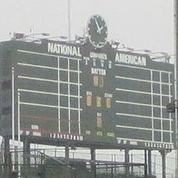 The scoreboard, eyelets removed and boarded up, umpires remain, as they did last year, CUBS remains