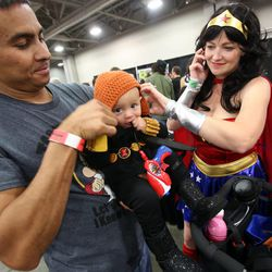 Dave and Laurisa Dixon dress their daughter Cassandra as Black Widow from The Avengers at Comic Con at the Salt Palace Convention Center in Salt Lake City on Saturday, Sept. 7, 2013.