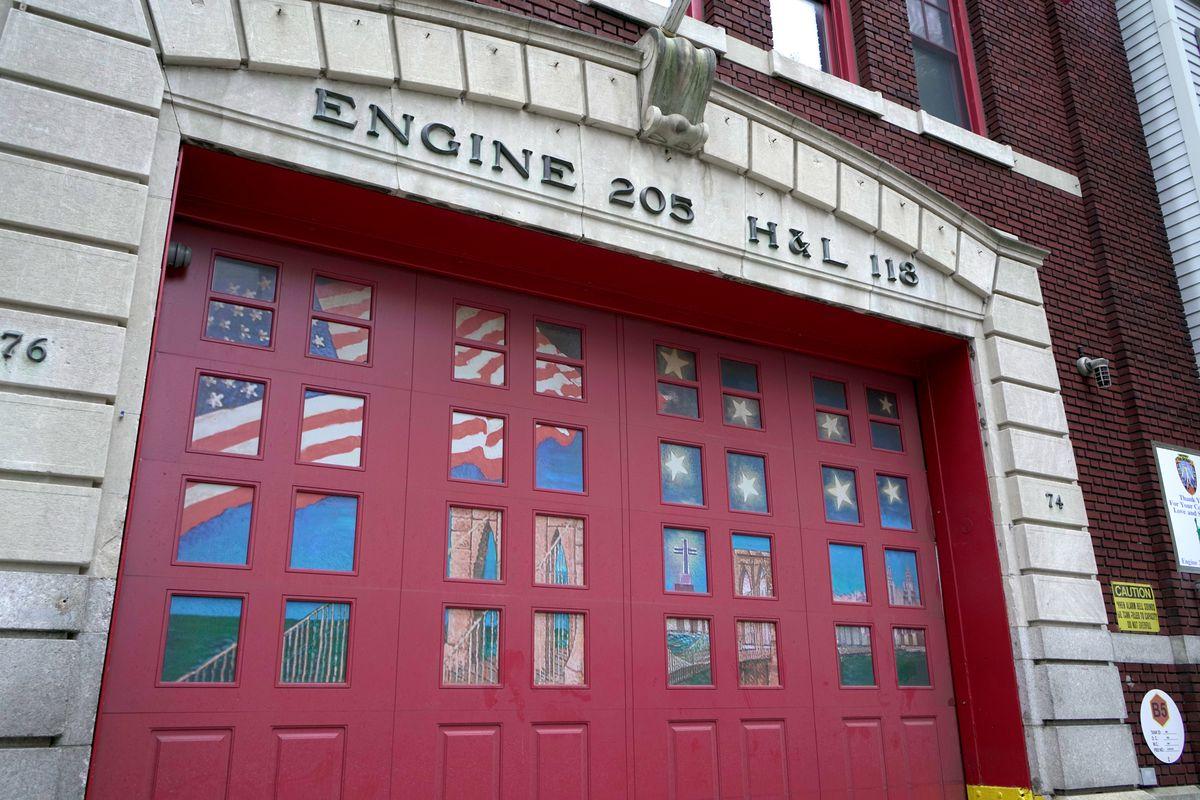 Currently 9/11 memorial art fills the windows of the garage door at Engine 205 in Brooklyn Heights.