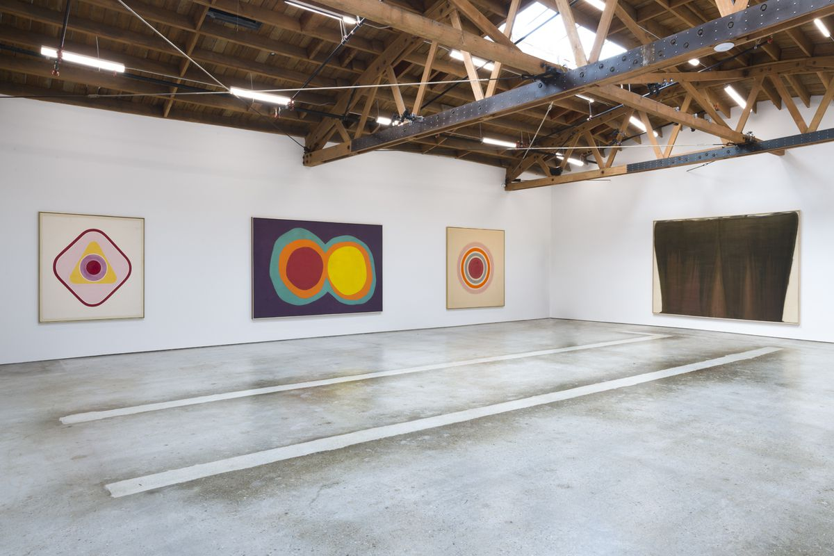 Gallery space with concrete floors and vaulted wood beam ceiling