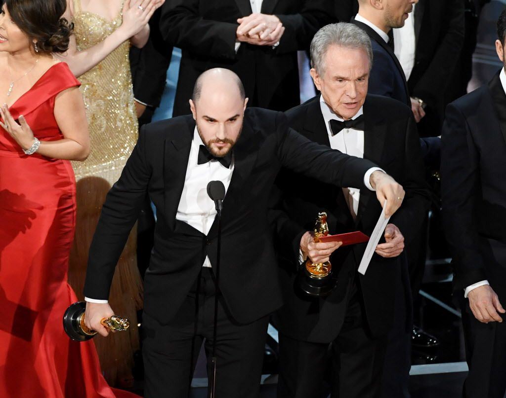 """<strong>""""La La Land' producer Jordan Horowitz holds up the winner card reading actual best picture winner """"Moonlight"""" with actor Warren Beatty onstage during the 89th Annual Academy Awards on February 26, 2017, in Hollywood, California. (Photo by Kevin W"""
