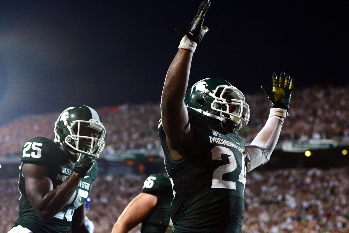 Aug 31, 2012; East Lansing, MI, USA; Michigan State Spartans running back Le'Veon Bell (24) celebrates after scoring a touchdown in the fourth quarter against the Boise State Broncos at Spartan Stadium. Mandatory Credit: Andrew Weber-US Presswire