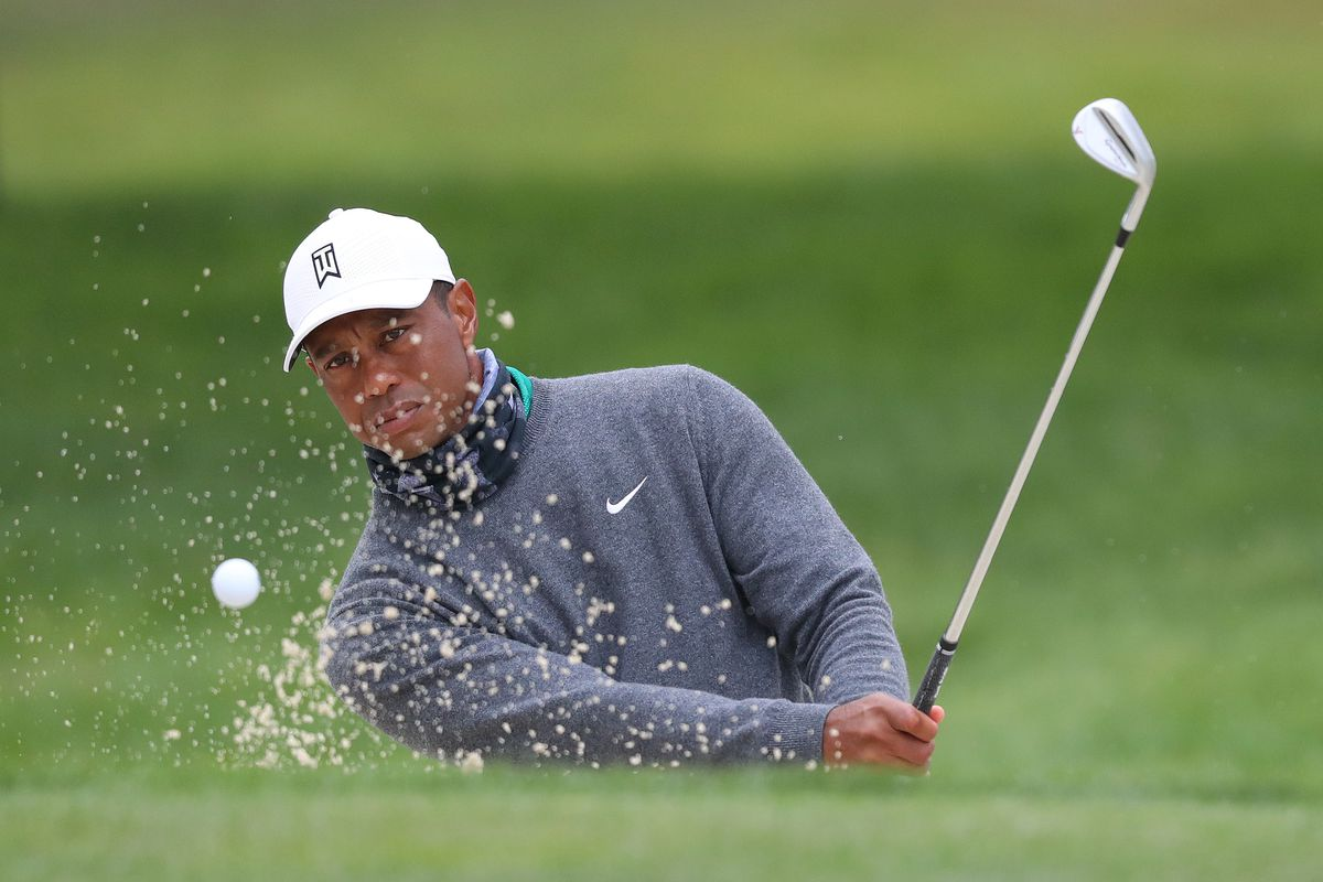 Tiger Woods of the United States plays a shot from the bunker during a practice round prior to the 2020 PGA Championship at TPC Harding Park on August 04, 2020 in San Francisco, California.